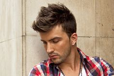 Get this Beckham-inspired hairstyles by wearing undercut sides with long textured hair on top.