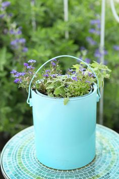 DIY Plant holder from painted paint cans are so cute and easy!    http://www.oldtimepottery.com/