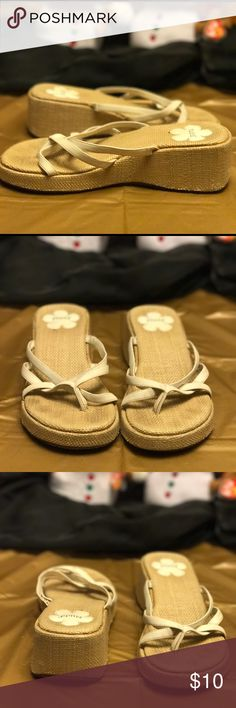 Super Cute Sandals! These are super cute tan wedge sandals! They are used but are in good condition. There isn't a size on these, but fits a 7 1/2 or size 8. The wedge is 2 inches. Length of shoe is 9 3/4 inches and the width of the shoe is 4 inches. Perfect for summer!👙☀️⛱ Mudd Shoes Sandals