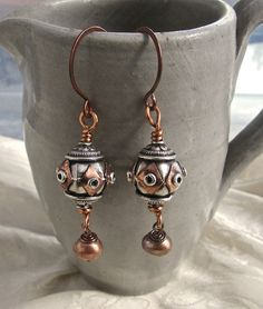 Gorgeous silver and copper handmade wire work Bali bead earrings with cocoa freshwater pearls. The hand forged antiqued copper ear wires are coated to help prevent sensitivity. Beach chic and earthy, great for your tropical vacation...