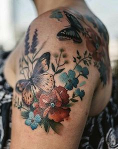 Fairytale-Inspired Tattoo Art That Looks Like Water Paintings- ellemag Inspirational tattoos Fairytale-Inspired Tattoo Art That Looks Like Water Paintings Pretty Tattoos, Unique Tattoos, Beautiful Tattoos, Butterfly With Flowers Tattoo, Butterfly Tattoo On Shoulder, Colorful Flower Tattoo, Tattoo Flowers, Butterflies, Shoulder Tattoos For Women