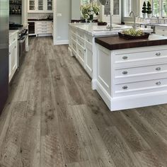Do you want the durability of vinyl but love the look of real wood? Farmhouse features rustic saw marks that give it a unique, reclaimed look that is to die for! Plus, it's waterproof. Vinyl Flooring Kitchen, Farmhouse Flooring, Luxury Vinyl Flooring, Luxury Vinyl Plank, Living Room Flooring, Waterproof Vinyl Plank Flooring, Best Flooring For Kitchen, Hardwood Floors In Kitchen, Modern Flooring