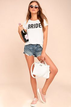 """Lulus Exclusive! Gather up your squad and hit the town in the Bride to Be White Tee! Soft jersey knit shapes this classic tee with a rounded neckline and short sleeves. Relaxed bodice has """"Bride"""" in bold black text."""