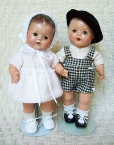 "These two are Arranbee Dream Baby toddlers, all composition, 10"" tall. I don't know if the clothing on the little boy is original or not. I suspect someone made them for him. I knit the dress to match the little boy's clothes."