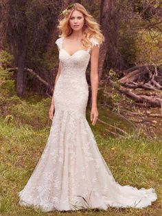 Maggie Sottero - LARISSA, Lace appliqués cascade down this strapless tulle fit-and-flare wedding gown, featuring a sweetheart neckline and light accents of pearls and beading on the bodice. Finished with corset closure or covered buttons over zipper and inner corset closure. Detachable cap-sleeves with lace appliqués sold separately.