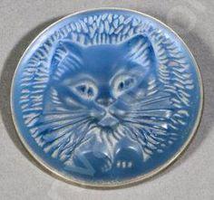 RENÉ LALIQUE. 'Cat' Brooch: silvered metal/ molded glass. From artvalue.com