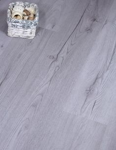 We love this medium grey laminate floor. It offers great quality at a low price and features realistic colours and grains in a beautiful wide plank effect. It's European made with a click system.