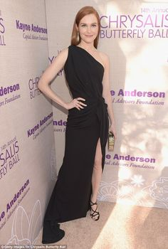 Leggy lady: Scandal star Darby Stanchfield looked regal in a black one-shoulder dress slas...