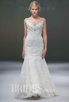 Brides.com: Eve of Milady - Fall 2014. Style 1517, ivory lace A-line wedding dress with a V-neck bodice covered in three dimensional accents, Eve of Milady