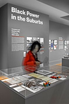 Archival artifacts are displayed throughout the exhibition.