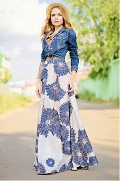 what caught my eye most was the way she is wearing her denim jacket, but I also love the skirt!
