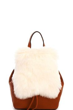 TREND: Fur, Boho MSRP: $74.00 SOLD IN: Nordstrom, Macy's, QVC BRAND: JOIA/Joseph D'Arezzo, Fashion Designer - Smooth Textured PU Leather - Adjustable Backpack Straps - Very Soft Fur on Flap - Magnetic
