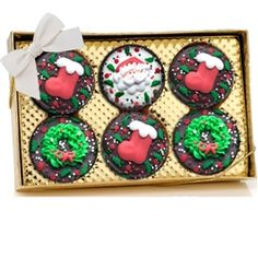 Christmas Chocolate Oreos® - Box of 6 -  	  These Christmas Oreo® Cookies are perfect for the Holidays! Wrapped in delicious fine gourmet Belgian Chocolates--Dark, Milk and White--and decorated with a beautiful assortment of 100% Hand Crafted Royal Icing Christmas Decorations*, and finished off with a generous shower of holiday sprinkles!  These are a perfect Christmas Gift or Corporate Gift for the Holidays.