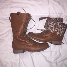 Combat boots Charlotte Russe tie-up boots. These boots have buttons on the sides which gives you an option to wear the boots folded down. The interior has an awesome leopard print! In great condition. Size 8 Charlotte Russe Shoes Combat & Moto Boots