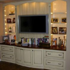 Use a dresser as the base of a built-in entertainment wall unit.
