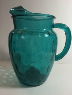 Hello There!  This is a bright bold and beautiful drink pitcher! great for summertime lemonade. This pitcher features upside down teardrop