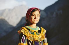"""chingizhobbes: """" Portrait of a girl in Tajikistan. Note the colorful """"atlas"""" silk material that is considered the most beautiful pattern for clothing in Uzbekistan and Tajikistan."""