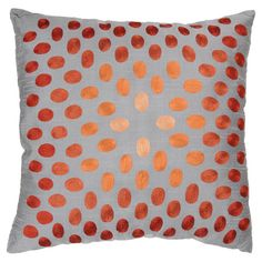 Add a pop of pattern to your living room sofa or reading nook arm chair with this jute and cotton pillow, showcasing a velvet polkadot motif.