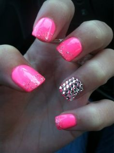 Pink nails with sparkles and rhinestones.