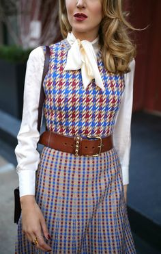 Click for outfit details! Blue, red and white checked knit dress, white tie-neck blouse, brown leather waist belt, white block heel pumps, suede burgundy crossbody bag {Tory Burch, YSL, fall fashion, what to wear on Thanksgiving, Thanksgiving outfit, classic fall dress, street style, classic dressing}