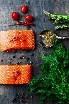 Delicious salmon fillet with aromatic herbs, spices and vegetables over wood background- healthy food, diet or cooking concept. Salmon Fillets, Seafood Soup Recipes, Raw Food Recipes, Seafood House, Raw Salmon, Wine Logo, Baked Salmon Recipes, Gastronomia, Trout