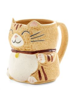 If you love cats as much as coffee, you're in for a treat - this ceramic tabby shares your exquisite taste and is always hot on the tail of your next refill! Greeting you each morning with the same sweet wave and whiskered smile, this friendly kitty complements your kitchen decor with a dappled caramel-brown glaze and strawberry-pink accents. Simply fill this charming companion to its ear-trimmed brim, then pounce on today's to-do list in precious style!