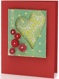 Make Shape Accents from Patterned Paper Design by Polly Maly Two pieces of patterned paper and a bit of adhesive foam add dimension to Polly's heart shape. She reinforced the background color with a cluster of buttons.  SOURCES: Cardstock: Bazzill Basics Paper. Patterned paper: Birdie Collection page kit. Buttons: Autumn Leaves.