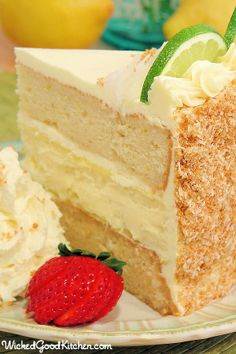 Key Lime Margarita Cheesecake Cake~ Key lime cheesecake and Margarita cake frosted with key lime curd and cream cheese buttercream with a coconut-macadamia nut graham cracker crunch..