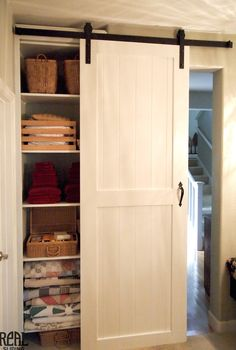 White Closet Sliding Barn Doors Linen In Laundry Room