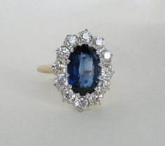Impressive Platinum and Gold Edwardian Diamond and Sapphire Ring