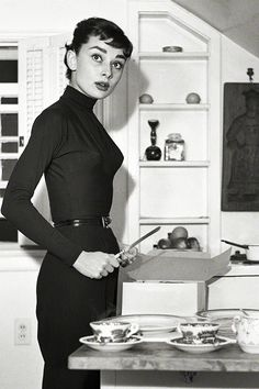Audrey Hepburn at home preparing and serving coffee and cake photographed by Earl Theisen for Look magazine, 1953