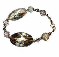 SALE Vintage Large Oval Gemcut High Shine Crystal Smokey Quartz Beaded Bracelet w/Asymmetrical Silver Accents & Matching Beads FREE SHIPPING - Only $4.95 on Etsy! (2 Available) https://www.etsy.com/listing/220157252/sale-vintage-large-oval-gemcut-high