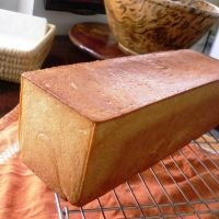 "Pain de mie bread - (France) ""Pain"" in French means ""bread"" or ""loaf of bread"" and ""mie"" means ""crumb."" It's most identical to pullman loaf or regular sandwich bread. This bread is usually used for making sandwiches or for toasting."""