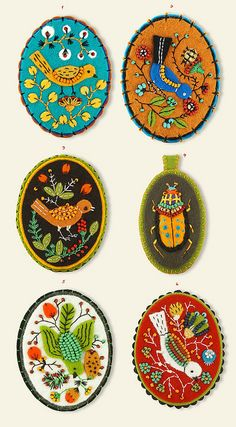 Elsa Mora 6 Embroidered felt brooches with bead accents.