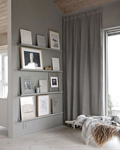 It's a grey kind of day... #bookwall #artwall #curtains #livingroom #stylizimohouse #greywalls