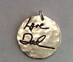 Memorial Jewelry. Your loved ones hand writing imprinted on a piece of jewelry. Beautiful. I will have to do this.
