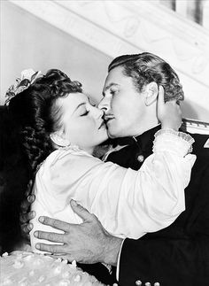 Olivia De Havilland  Errol Flynn.