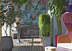 Designer: Vick Vanlian Architecture and Design, Beirut, Lebanon A gorgeous floral wall mural enhances this outdoor living area. With coordinating rattan furniture and pretty planters, this is truly a summer haven.