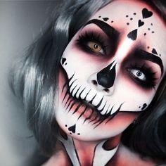 Haunted hearts . This look is inspired by the work of @jordanliberty . . EYES @camoeyes @smashboxcosmetics shadow @urbandecaycosmetics shadow @velourlashesofficial false lashes @katvondbeauty liner +brows . . FACE @mehronmakeup white @kryolanofficial orange @katvondbeauty black details . RINGS are @rogueandwolf . . #halloweenmakeup #skullmakeup #skeletonmakeup #mehronmakeup #kryolan #facepaint #rogueandwolf #goth #queenofhearts #greyhair #greywig #chantalpaints