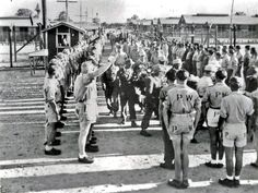 Photo: University of North Texas Libraries.German WWII POWs in Fort Bend County.Undated photo. It shows the funeral procession for a dead German POW inmate in Rosenberg. The camp was located on the old Fort Bend County Fair Grounds, where the Fiesta supermarket now stands.Notice the lone diehard who's giving the Nazi salute. Look closer, and you can see a few more in the distance.