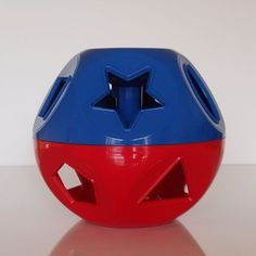 $22.99 TUPPERWARE Shape O Ball Toy. TUPPERWARE Shape O Ball ToyClassic rattle, shape-sorter and counting toy! Heres a toy that grows with a child, from infants to pre-schoolers. As a rolling rattle, it has lots of open spaces for infants to grab. Toddlers can use the 10 pieces to match the shapes on the toy, allowing them to identify shapes and develop coordination and dexterity. Each piece also has a number on one side with the corresponding number of dots on the other to teach preschoolers n