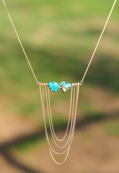 Set In Stone Necklace with horizontal bar and turquoise stones and dangling gold chains