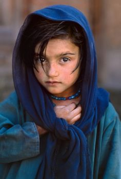Girl In Blue - Kashmir.  Intriguing look on her face, and . . .I WANT THOSE BEADS!