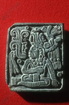 Jade carving from Palenque.Relief showing depiction of a seated man wearing noble clothing with a feather headdress (made from jade). Jade, from before 675). Found in the Crypt of the Pyramide of inscriptions in Palenque, the pyramid of the King Pacal (ruler of the town of Palenque 615 – 683). Mexico-City, Museo Nacional de Anthropologia (Mexico). | akg-images