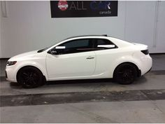 """""""Car - 2010 Kia FORTE KOUP SX   LEATHER   SUNROOF   BLUETOOTH   TINT in Guelph, ON  $12,988"""""""