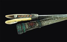 "Ottoman Yatagan Short Sword  Dated: 18th century Culture: Ottoman Measurements: overall length is 21"", blade length is 15"" This particular Turkish yatagan features an European triangular, straight, etched blade. The scabbard is made of wood with low grade silver mounts decorated with 98 gems. The grip of typical shape is of bone with silver rib decorated with large corals.  Source: Copyright © 2014 eBay"