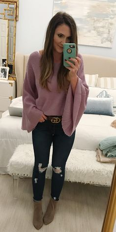 #winter #outfits purple scoop-neck batwing-sleeve shirt and distressed blue-washed skinny jeans outfit