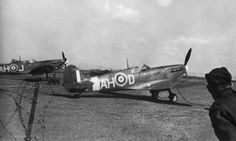 Two of 332 Squadrons Spitfires in 1942. In the background, Finn Thorsagers AH-J