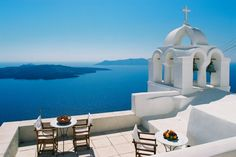 Greece!!! Relaxing just imaging sitting in the chair and looking at that gorgeous view.