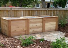 Cedar 3 bin composter with mesh lids.  Slats can be removed for easy working.